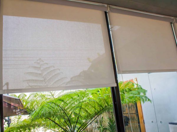 White curtains or Roller blind use sun protection and beautiful.