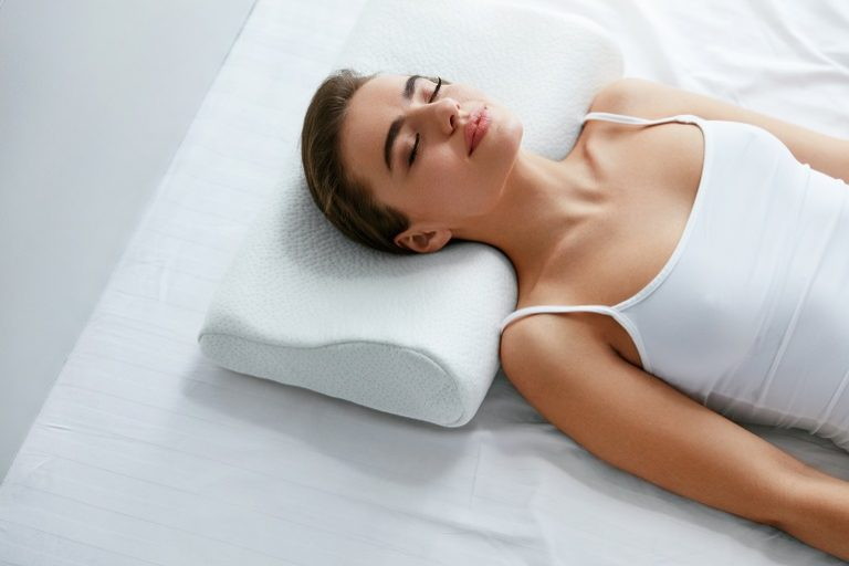 Healthy Sleep. Woman Sleeping On White Orthopedic Pillow