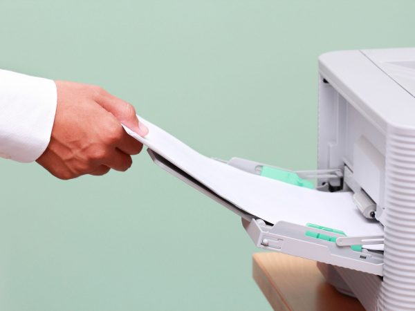 15212486 – businessman working with printer in the office