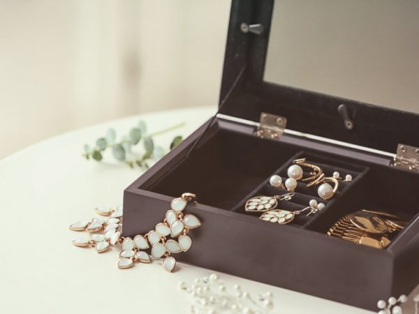 Collection of bijouterie in jewelry box on table