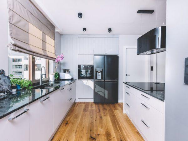 Modern kitchen interior design. Wooden floor and quartzite tabletop