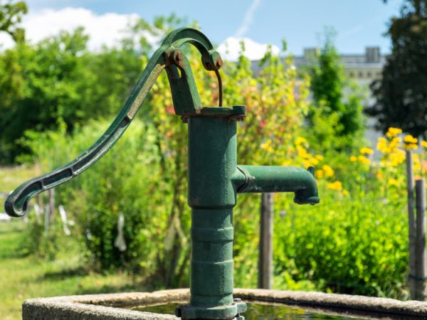 Manual water pump at Klenze Park in Ingolstadt, Germany in the summer
